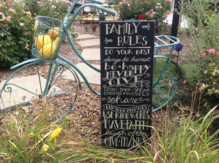 painted-bike-in-spring-yard-with-family-sign