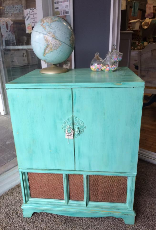 turquoise-cabinet-with-globe