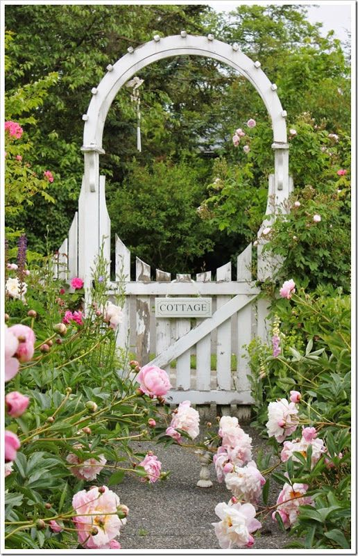cottage white door with peonies entrance to garden